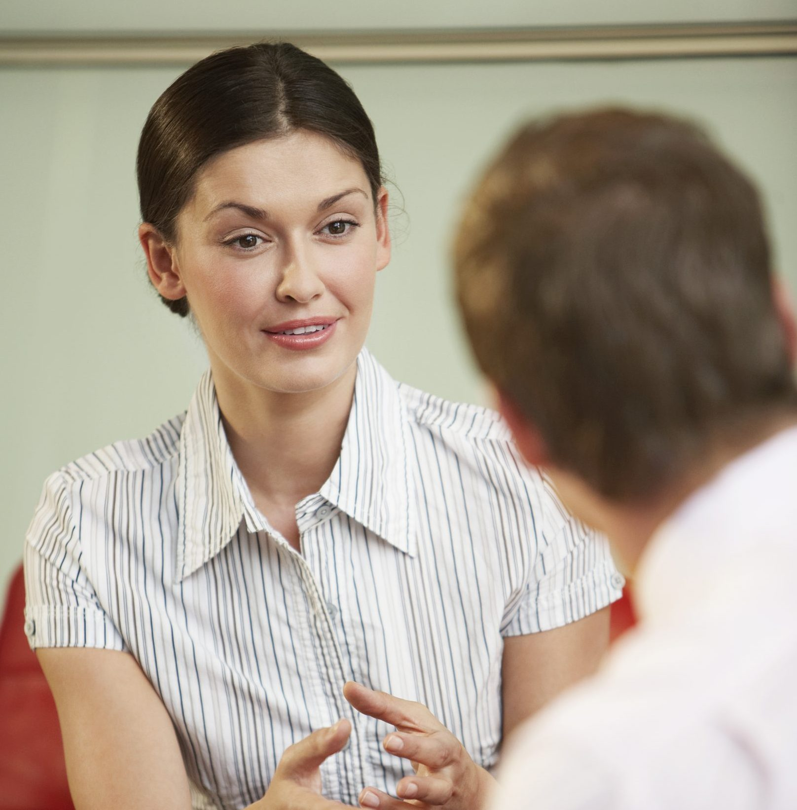 A woman doing an ACCENT REDUCTION MODIFICATION SPEECH THERAPY