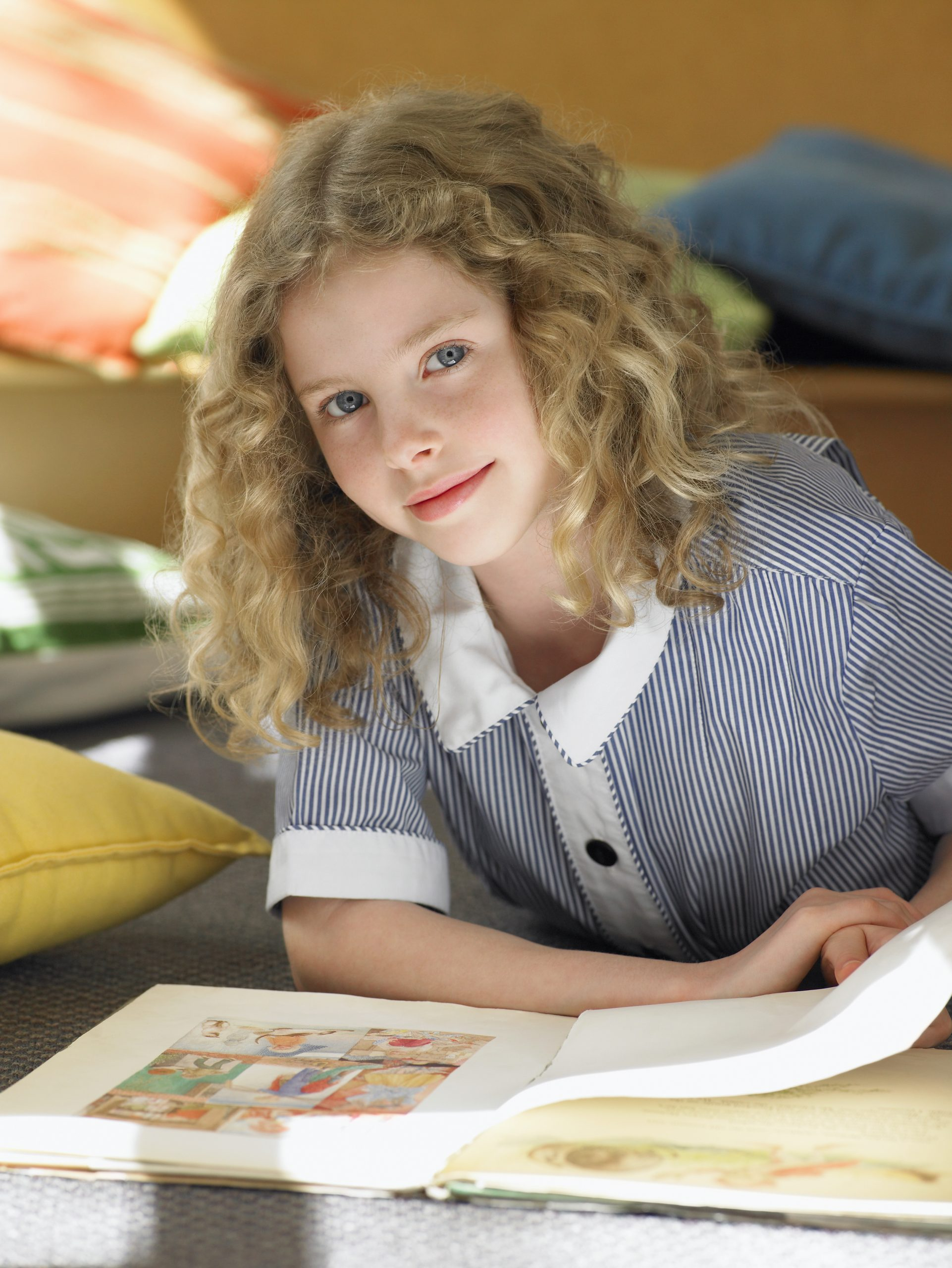 A girl reading 2021 Reading Model for Fluency Comprehension Self Regulation and Vocabulary scaled 1