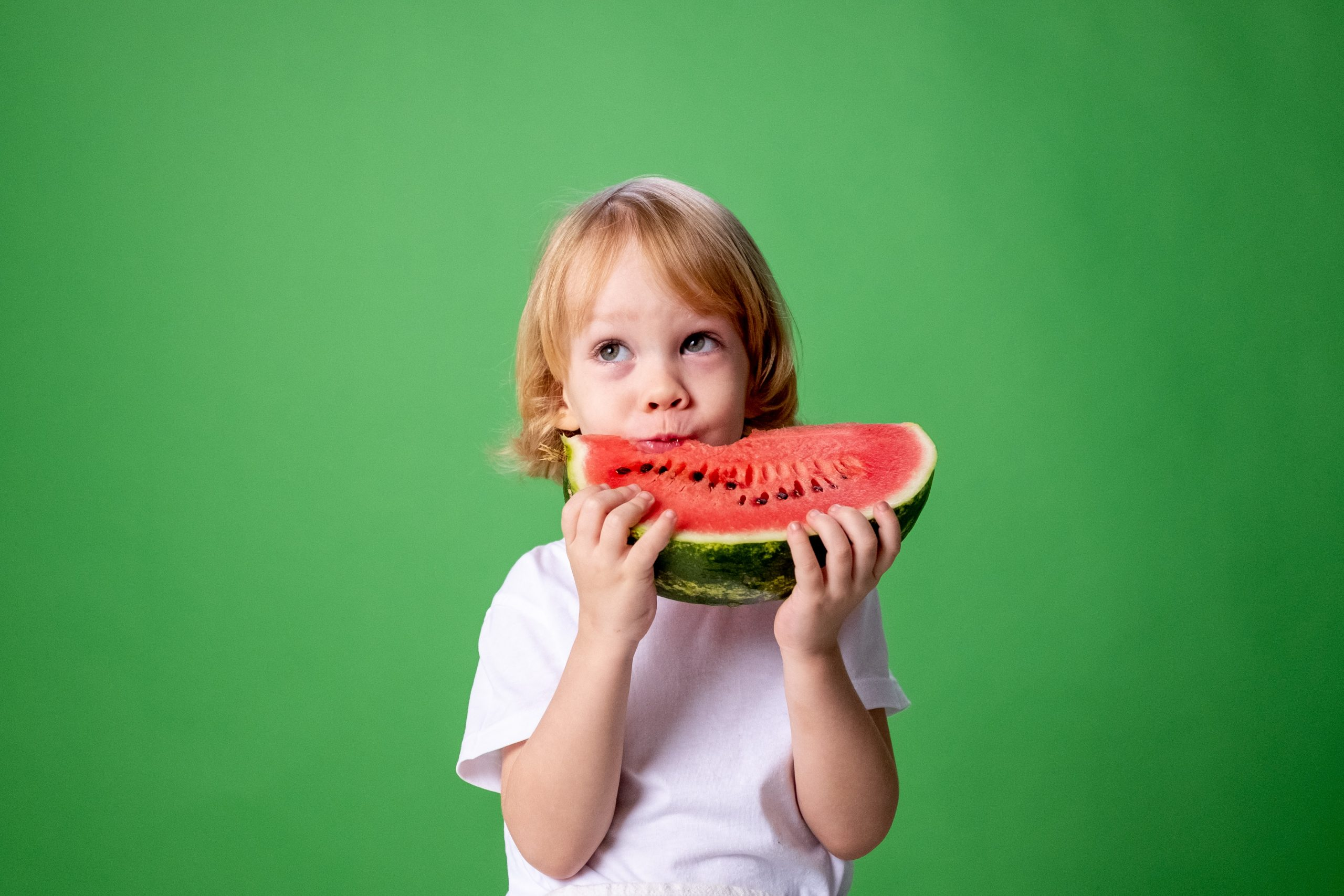 A toddler eating a watermelon Speech language feeding testing assessments scaled